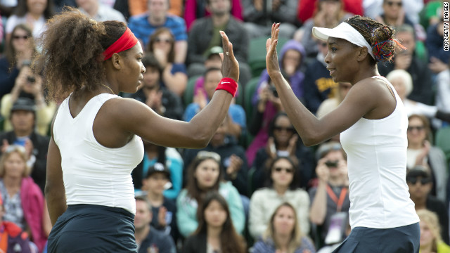 Venus Williams (left) and sister Serena celebrate after beating Romania's Sorana Cirstea and Simona Halep in the doubles.