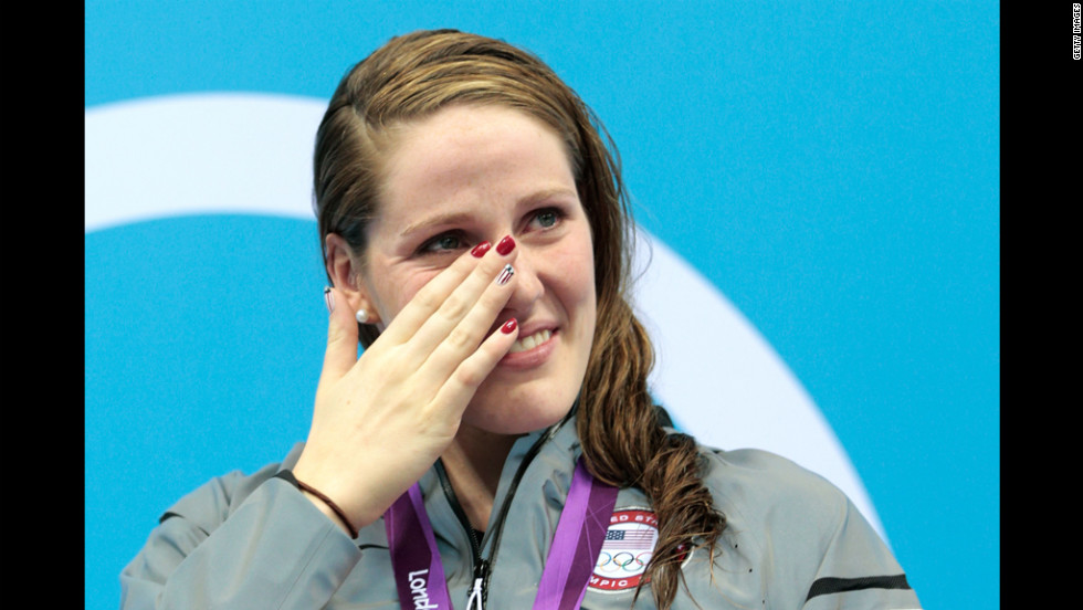 Missy Franklin of the United States wipes a tear from her face as she reacts during the medal ceremony for the women's 100-meter backstroke on Monday.