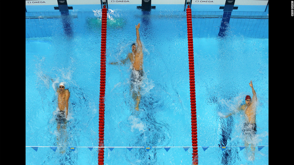 From left, Camille Lacourt of France, Matt Grevers of the United States and Liam Tancock of Great Britain compete the final of the men's 100-meter backstroke on Monday.