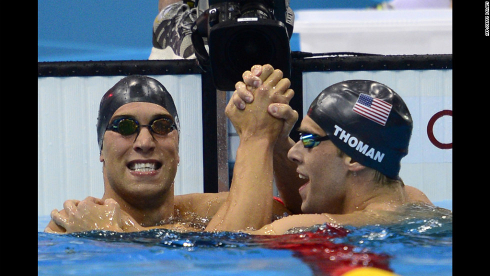 American Matthew Grevers (left) celebrates winning gold with silver medalist and fellow  American Nick Thoman at the finish of the men's 100-meter backstroke final swimming on Monday.