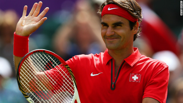 Roger Federer celebrates after beating France's Julien Benneteau on day three of the London 2012 Olympics.
