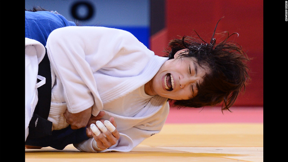 "Korea's Jan-Di Kim, in white, takes on Mongolia's Sumiya Dorjsuren during the women's 57-kilogram judo contest on Monday. See <a href=""http://www.cnn.com/2012/07/31/worldsport/gallery/olympics-day-four/index.html"" target=""_blank"">day four of the competition</a> from Tuesday, July 31."