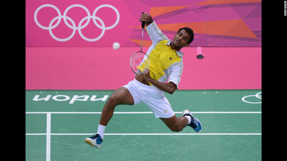 Niluka Karunaratne of Sri Lanka hits a return during his men's singles badminton match on Monday.