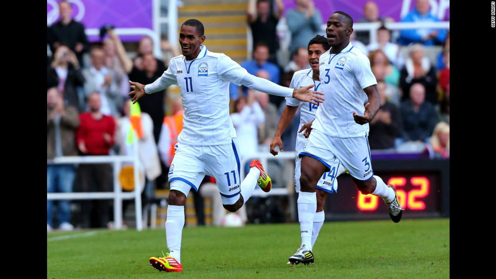 Jerry Bengtson of Honduras celebrates after scoring in the team's first-round soccer match against Spain.