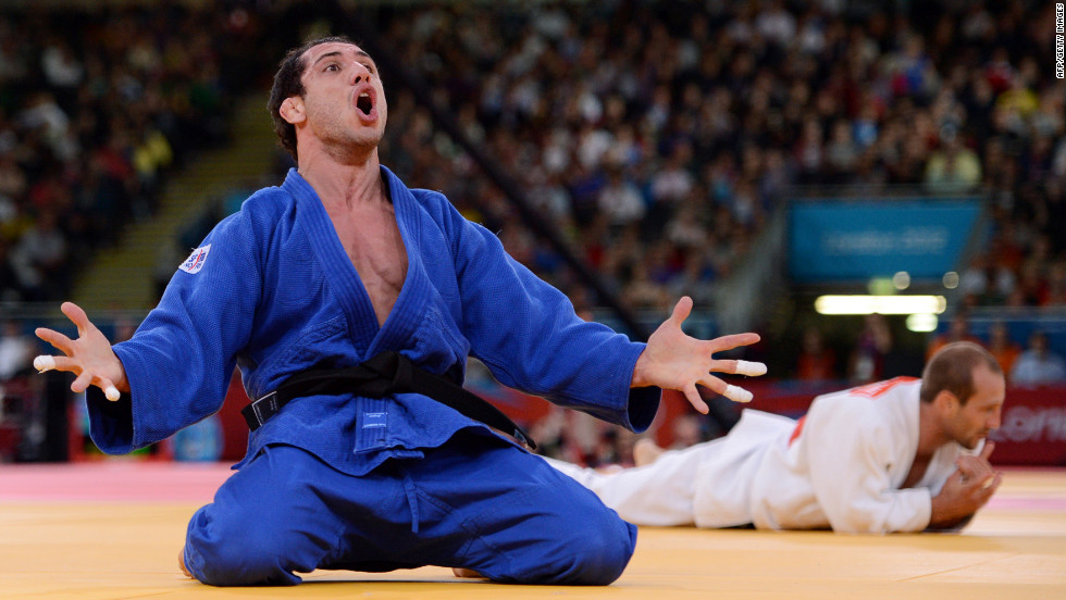 Argentina's Emmanuel Lucenti celebrates after beating France's Alain Schmitt in the men's under 81-kilogram judo contest match Tuesday.