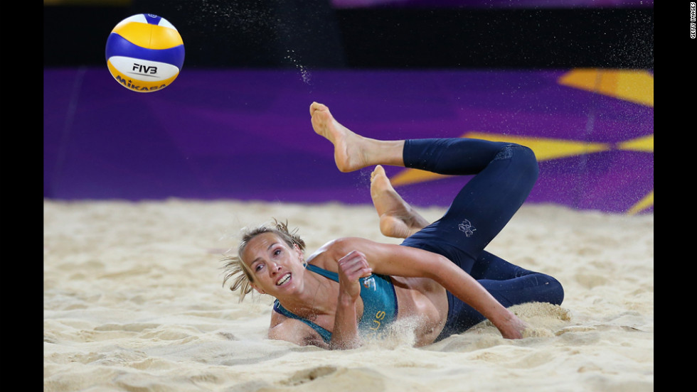 Tamsin Hinchley of Australia dives for a shot during the women's beach volleyball preliminary match between Australia and Austria.