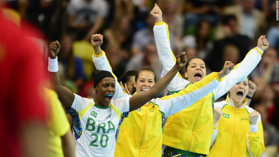 Brazilian players celebrate their victory over Montenegro at the end of the women's preliminaries handball match.