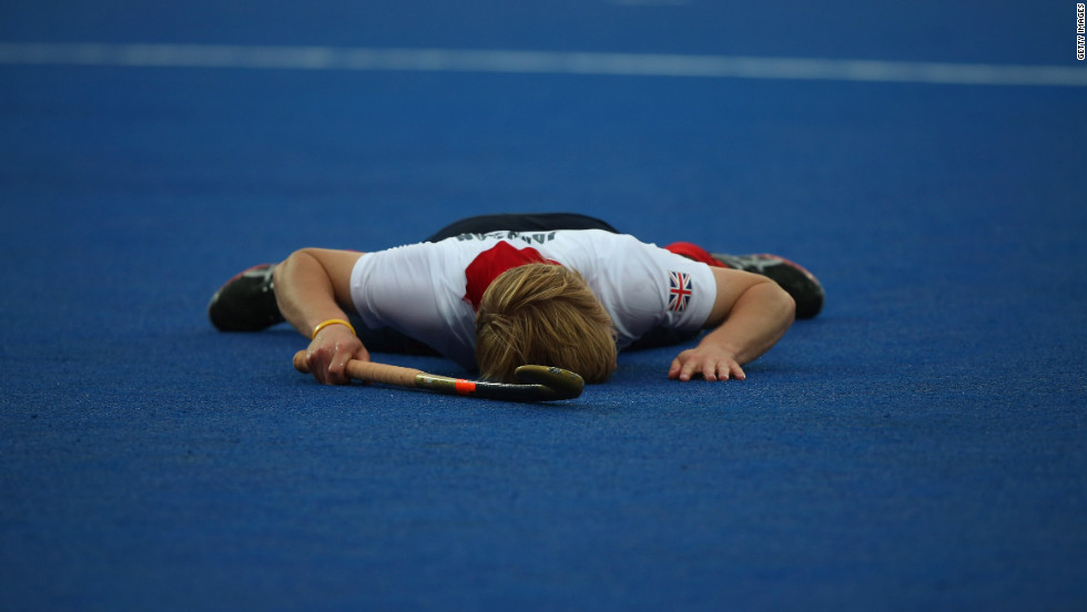 Ashley Jackson of Great Britain lays on the floor after missing a shot during the men's field hockey match between Great Britain and Argentina on Monday.