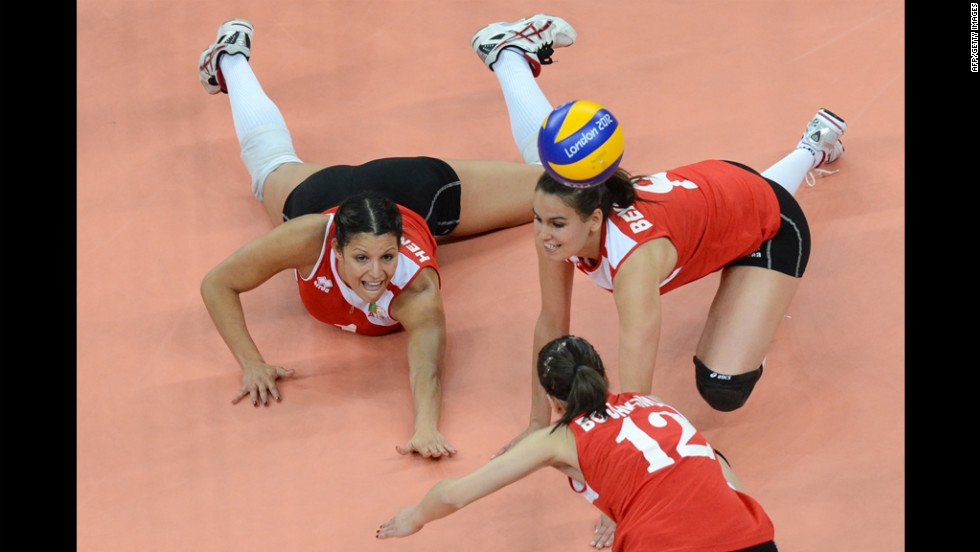 Algeria's Zohra Bensalem (right) and Sehryne Hennaoui attempt to set during the women's preliminary volleyball match between Britain and Algeria.
