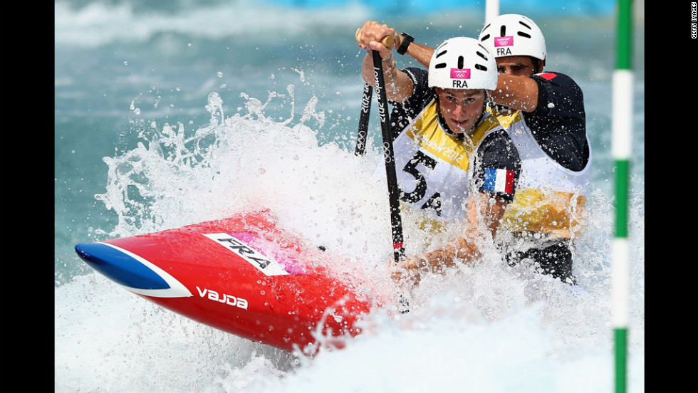 Gauthier Klauss and Matthieu Peche of France compete in the men's canoe double slalom heats.