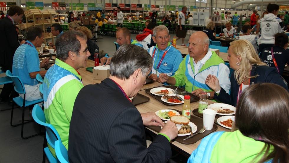 Danilo Turk, the president of Slovenia, visits the dining hall on day one of the London 2012 Olympics.