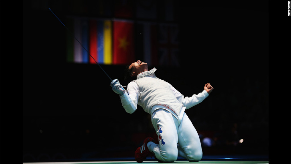 Byungchul Choi of South Korea celebrates winning during the quarterfinals of the men's foil individual.