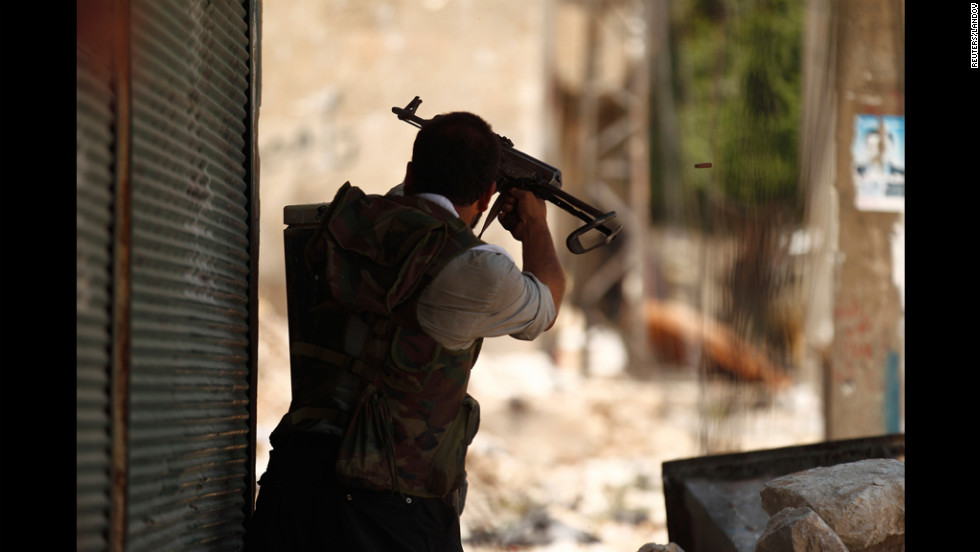 A member of the Free Syrian Army fires at forces loyal to President Bashar Al-Assad in a district of Aleppo called Salah Edinne on Tuesday.