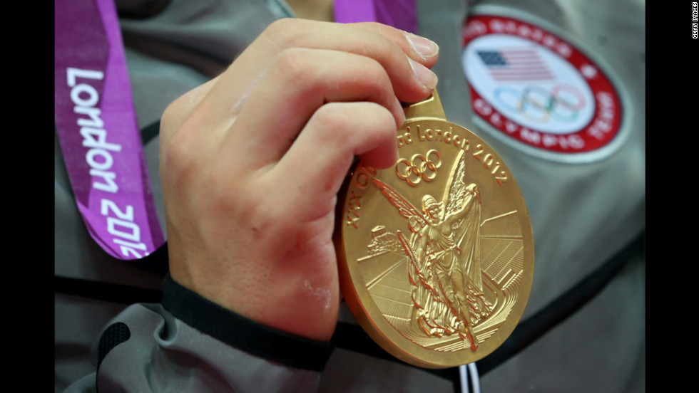 The gold medal hangs from the Olympian's neck.