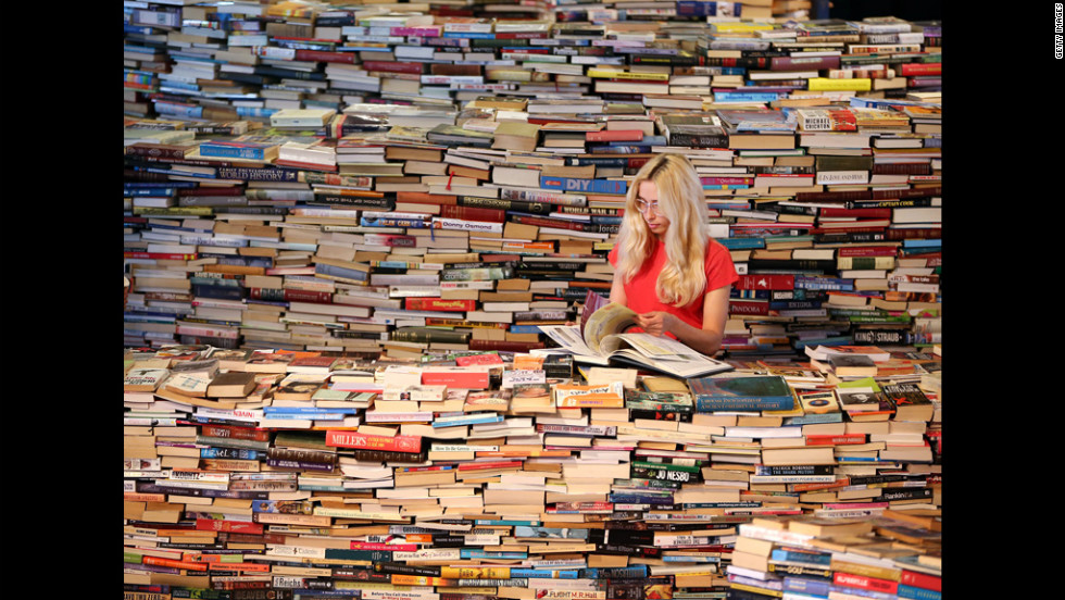 Employee Tilly Shiner looks at a book in the aMAZEme labyrinth, made up of 250,000 books, at The Southbank Centre on Tuesday in London.