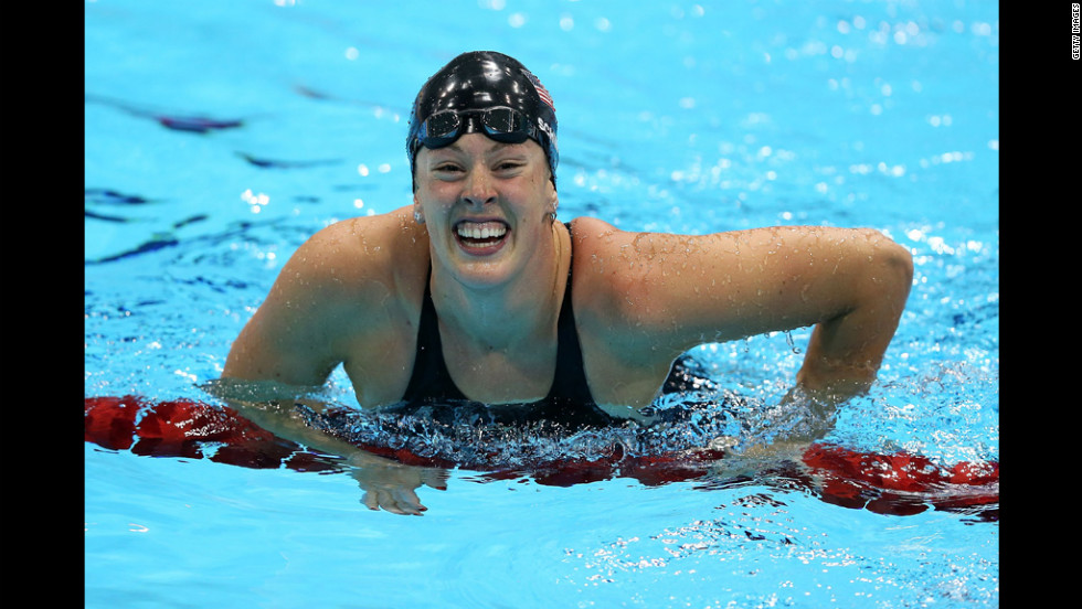 Allison Schmitt celebrates in the water after winning the gold.