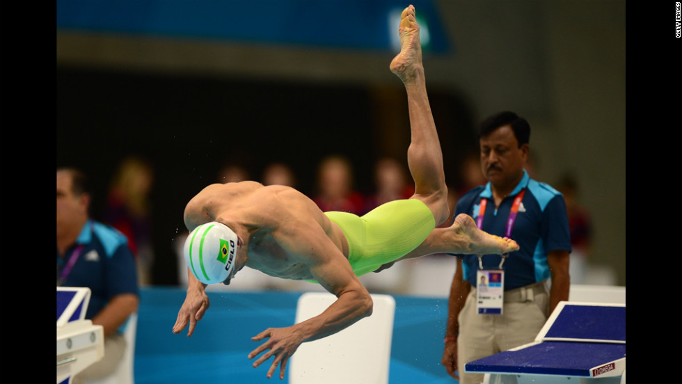 Brazil's Cesar Cielo dives in for the men's 100-meter freestyle heat Tuesday.