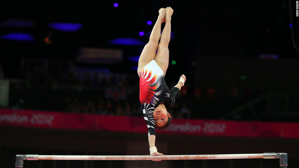 Koko Tsurumi of Japan competes on the uneven bars in the women's gymnastics event.