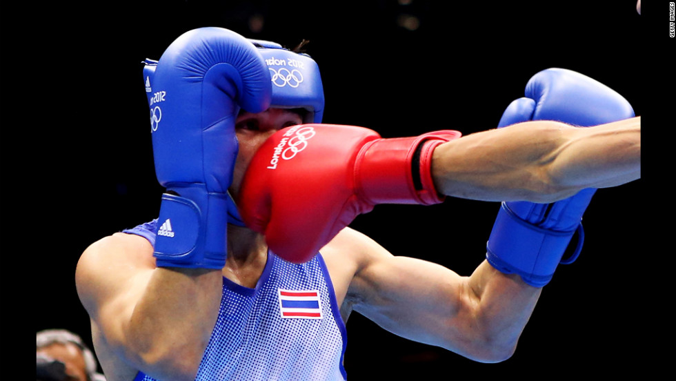 Kaeo Pongprayoon of Thailand boxes Mohamed Flissi of Algeria.