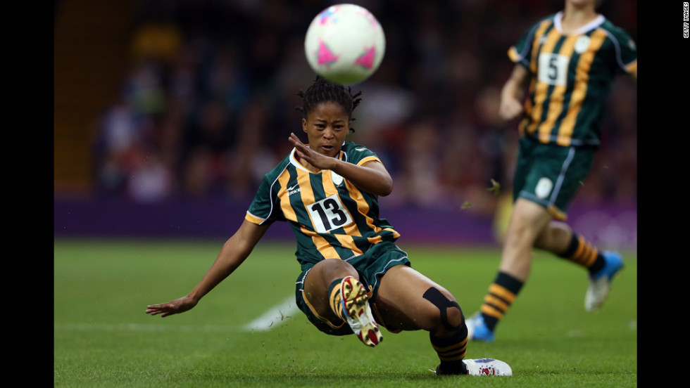 Gabisile Hlumbane of South Africa kicks the ball during the women's first-round soccer match against Japan.