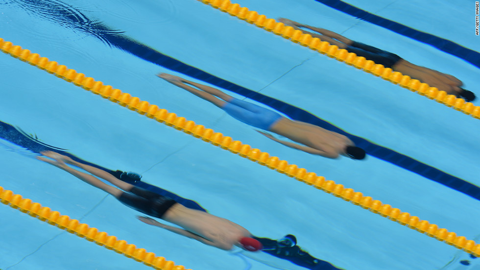 From left, Britain's Andrew Willis, Hungary's Daniel Gyurta and Japan's Kosuke Kitajima compete in the men's 200-meter breaststroke semifinal.