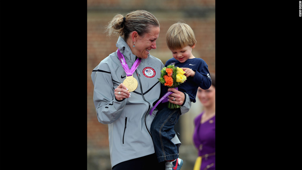 Armstrong celebrates the gold with her son, Lucas, during the medal ceremony.