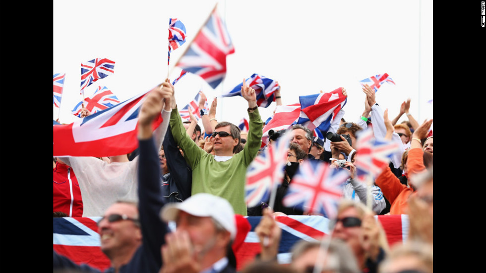 British fans wave Union Jacks as they enjoy the atmosphere at Eton Dorney.