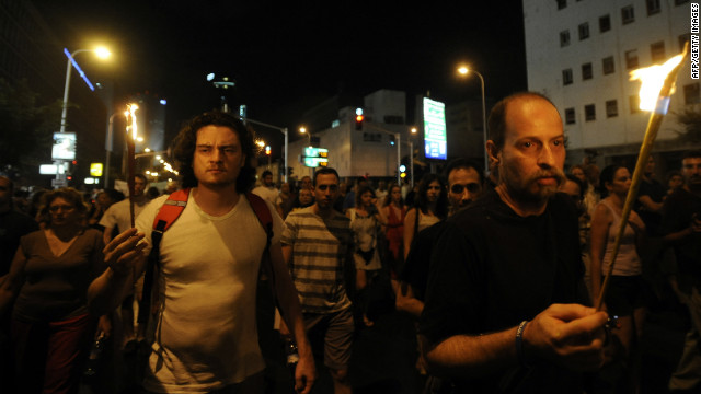 Israelis attend a demonstration in Tel Aviv on July 21 in memory of  the first protester who set himself alight on July 14.