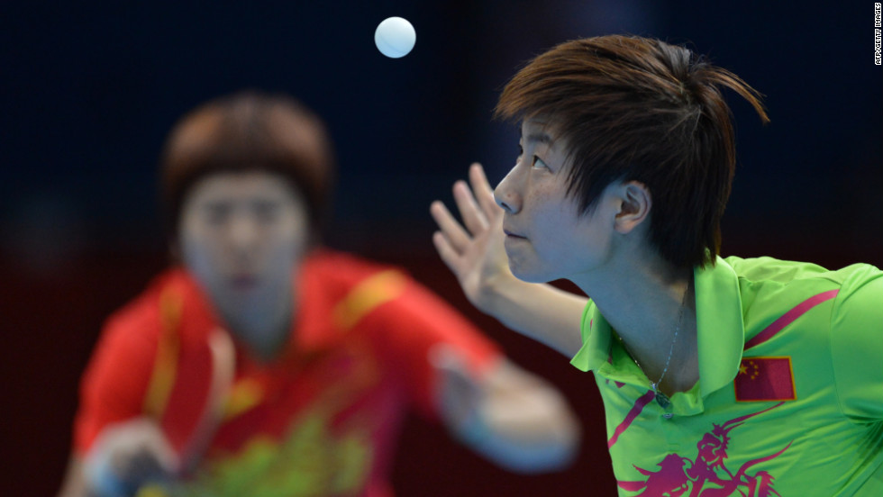 China's Ding Ning, right, serves during her table tennis women's gold medal singles match against compatriot Li Xiaoxia.