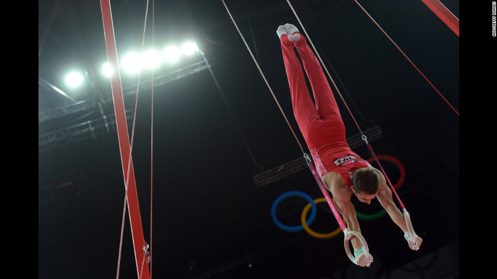 Russia's David Belyavskiy performs on the rings during the men's individual all-around competition of the gymnastics event.