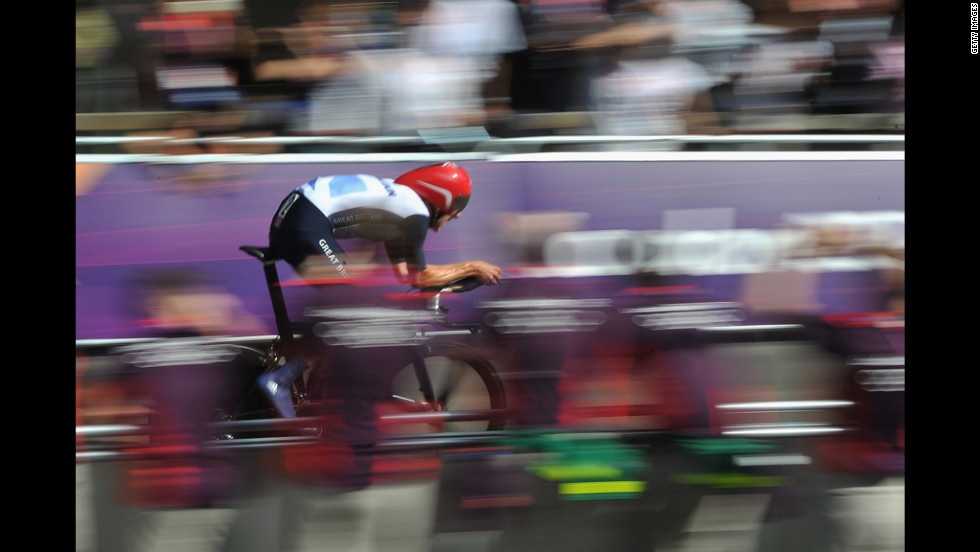 Bradley Wiggins of Britain competes in men's individual time trial road cycling.