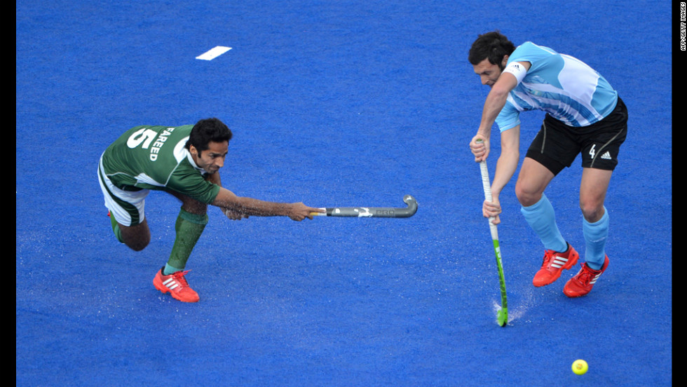 Pakistan's Fareed Ahmed, left, plays a shot against Argentina's Matias Damian Vila during a men's field hockey preliminary.