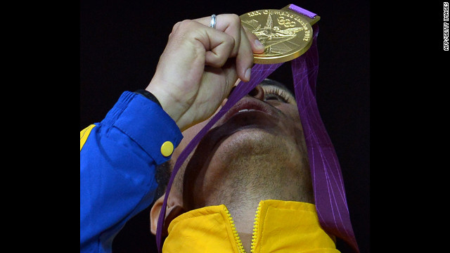Venezuela's Ruben Limardo celebrates with his gold medal on the podium during the victory ceremony for the Men's Fencing Epee gold medal in London, England on Wednesday.