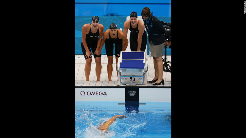 From left, Shannon Vreeland, Dana Vollmer and Missy Franklin watch teammate Allison Schmitt finish first to win the relay.