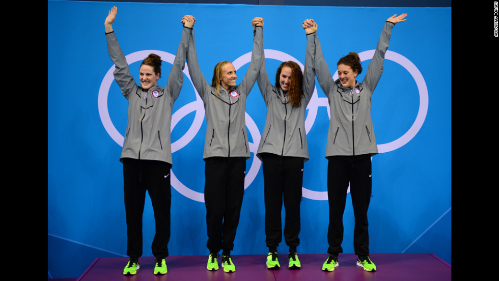 Missy Franklin, Dana Vollmer, Shannon Vreeland and Allison Schmitt celebrate on the podium after taking the gold in the women's 4x200-meter freestyle relay on Wedesnday. It was the United States' eighth gold in swimming.