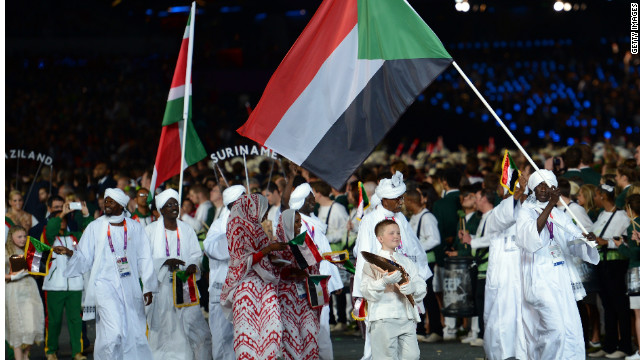 Sudan's team parades. Frida Ghitis says coverage of the Games overlooks fascinating stories of athletes from other nations.