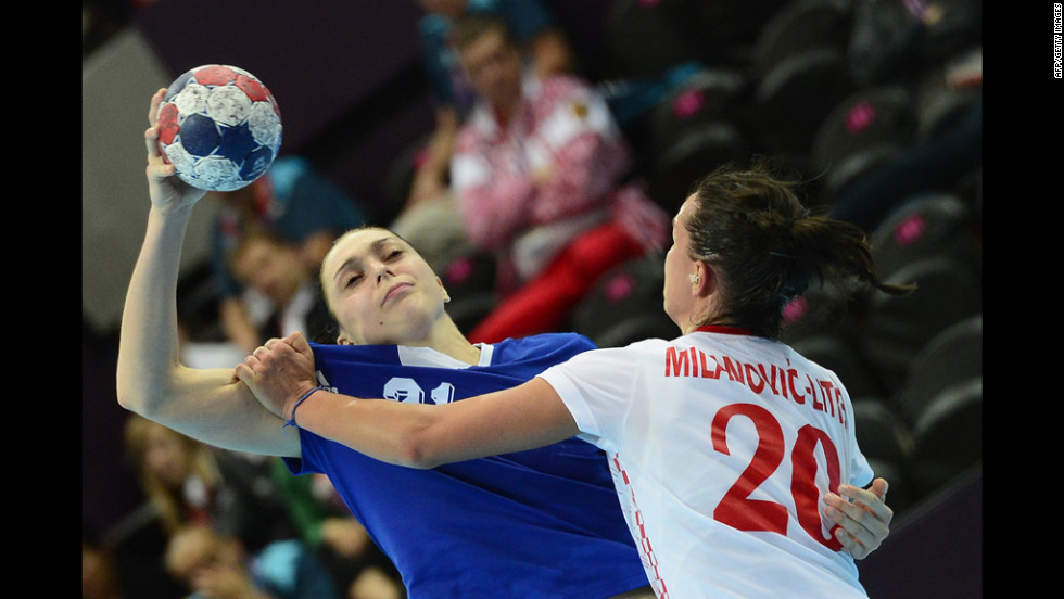 Russia's left back Victoria Zhilinskayte, left, vies with Croatia's pivot Vesna Milanovic-Litre during the women's preliminaries group B handball match.