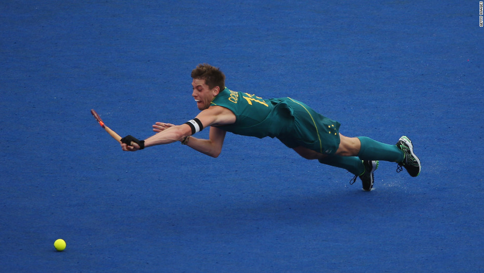 Captain Edward Ockenden of Australia dives for the ball during the men's preliminary field hockey match against Spain on Wednesday.