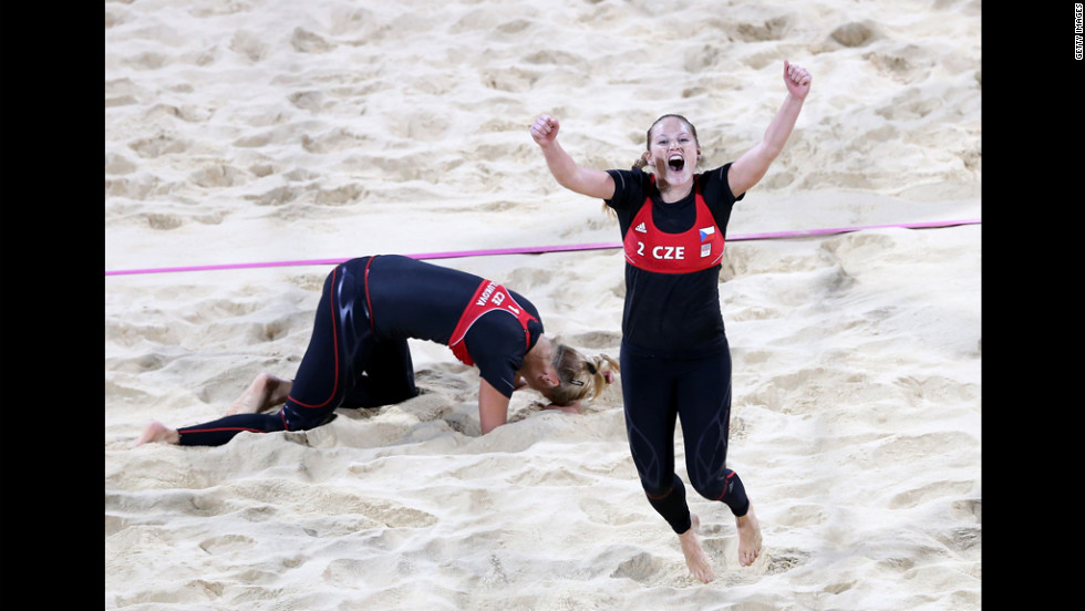 Kristyna Kolocova, right, and Marketa Slukova of the Czech Republic celebrate after winning their match against Australia during women's beach volleyball.