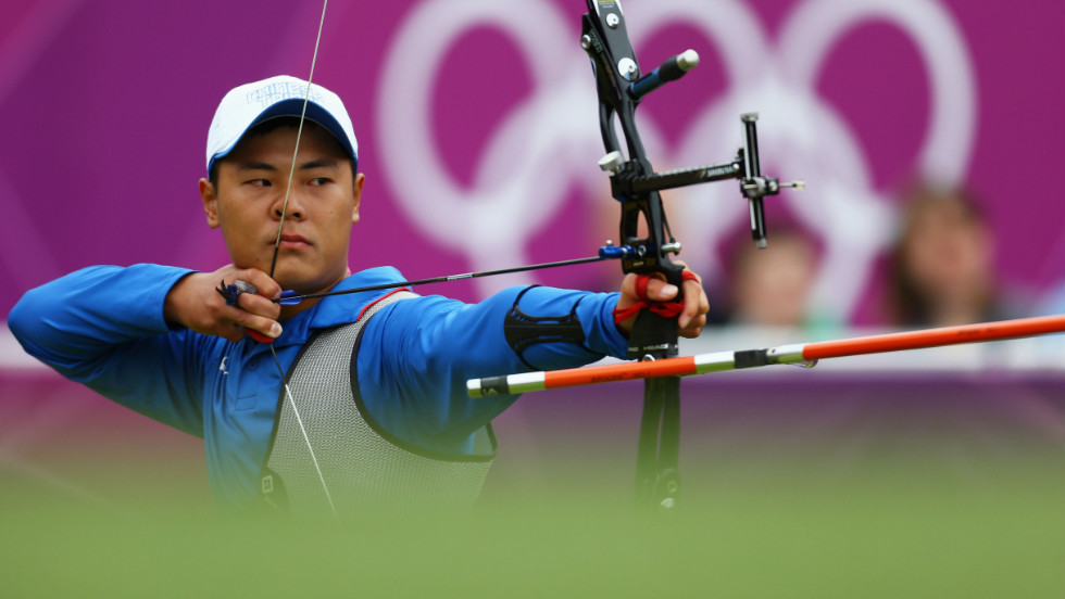 "Chen Yu-Cheng of Chinese Taipai competes Wednesday in the men's individual archery 1/16 eliminations match against Viktor Ruban of Ukraine. Check out photos from <a href=""http://www.cnn.com/2012/08/02/worldsport/gallery/olympics-day-six/index.html"" target=""_blank"">Day 6 of the competition.</a>"