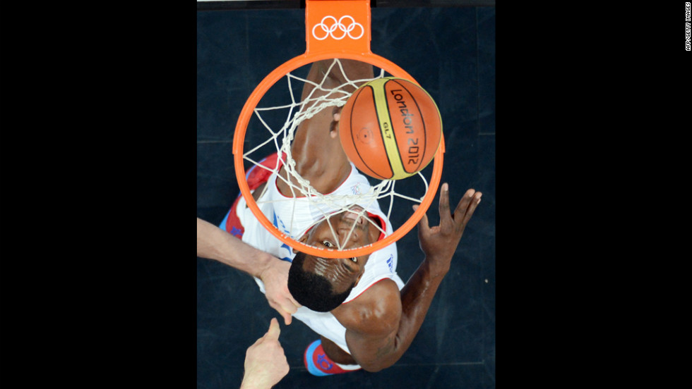 French forward Florent Pietrus eyes the ball during the men's preliminary basketball match against Argentina.