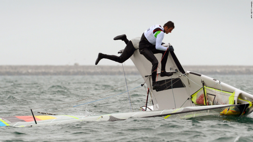 Germany's Hannes Baumann and Tobias Schadewaldt attempt to right their skiff in the 49er sailing class in Weymouth, England.