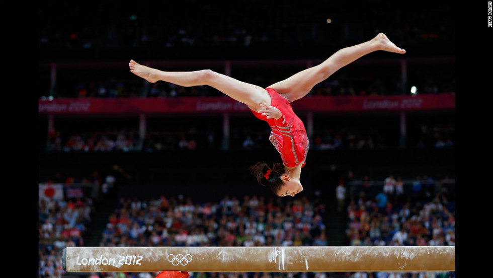 Kyla Ross of the United States competes on the balance beam in the women's gymnastics team final.