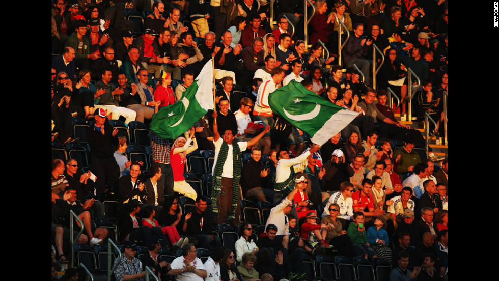 Pakistan fans show their support during the men's preliminary hockey match between Argentina and Pakistan in London.