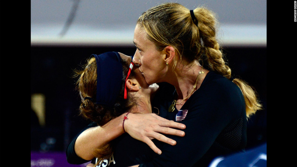 Misty May-Treanor and Kerri Walsh of the United States celebrate their win against Austria's Doris Schwaiger and Stefanie Schwaiger in the women's beach volleyball preliminary phase group C match.
