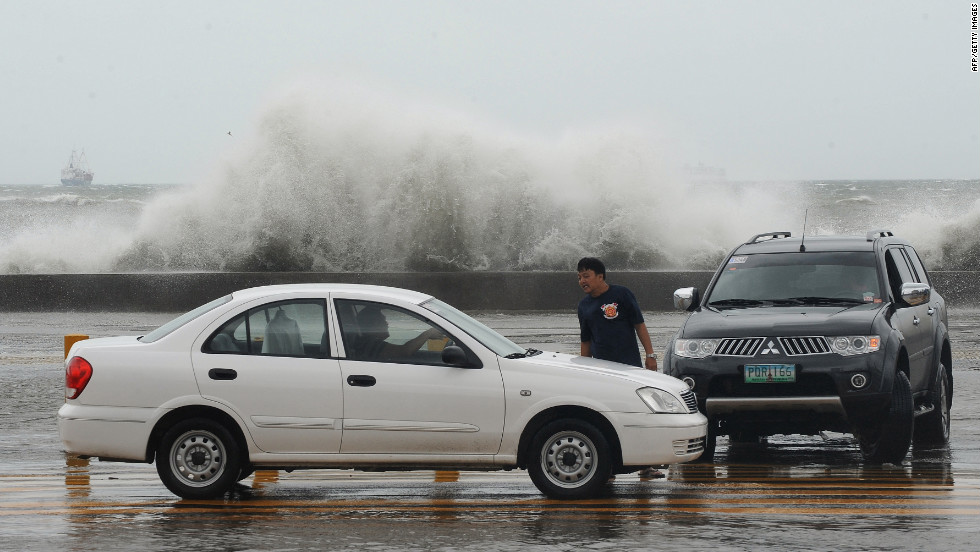High waves splash up Wednesday along Toxas Boulevard, the famous roadway that runs along Manila Bay.