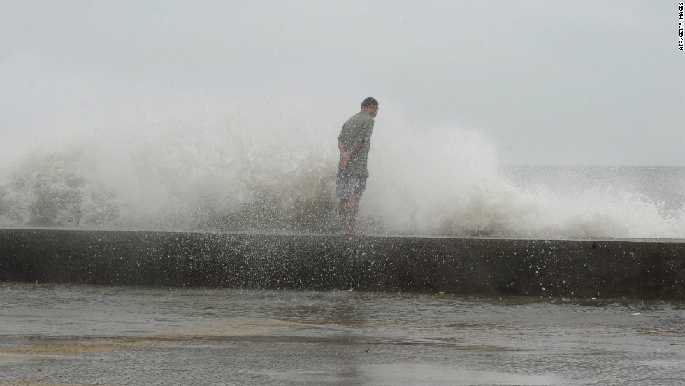 A man braves high waves along Manila's Roxas Boulevard on Wednesday.