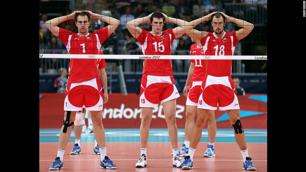 Bulgarian volleyball players, from left, Georgi Bratoev, Todor Aleksiev and Nikolay Nikolov wait for the serve in the second set against  Australia.