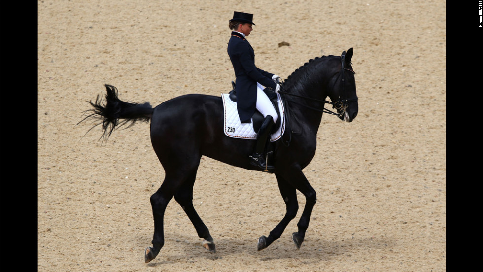 Dorothee Schneider of Germany rides Diva Royal in the dressage grand prix in Greenwich Park in London.