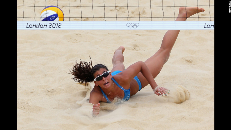 Italy's Marta Menegatti dives for a shot during a beach volleyball preliminary match against Canada.
